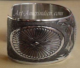 Authentic American Indian Native Jewelry, this navajo bracelet hallmarked Tom Platero is made from sterling silver.